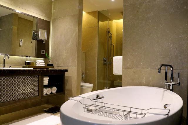 Stay at JW Marriott Mumbai Sahar bathroom